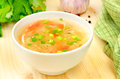 Sauerkraut soup in white bowl on wooden table Stock Photography