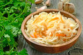 Sauerkraut in the wooden bowl Stock Image