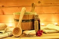 Sauna accessories with sauna oil, wooden bucket, ladle, towels Royalty Free Stock Photo