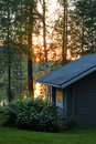 Sauna cottage in midsummer night near lake Royalty Free Stock Photo