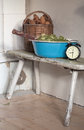 Sauna time still life with enamelled tub besom kindling and alarm clock Stock Photography