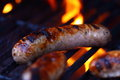Sausage on barbecue a photograph of with flame Royalty Free Stock Images