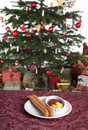 Sausage for christmas two with ketchup and mustard on a table in front of a tree Royalty Free Stock Photos