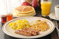 Sausage egg and pancake breakfast scrambled eggs with hash browns pancakes Stock Photo