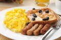 Sausage and eggs with french toast Stock Photos