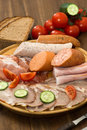 Sausage plate with bread and tomatoes Stock Image