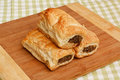 Sausage roll kitchen setting freshly baked rolls in a traditional a popular pastry snack available hot or cold from any english Royalty Free Stock Photo