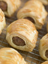 Sausage Rolls on a Cooling Rack Royalty Free Stock Photo