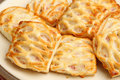 Sausage rolls with lattice pastry freshly baked shallow dof sharp focus on lh roll Stock Images