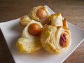 Sausage rolls on a plate wooden table Royalty Free Stock Image