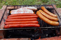 Sausages on barbecue different kinds of Stock Photography