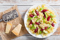 Sausages bowtie Pasta warm salad with avocado slices and cheese Royalty Free Stock Photo