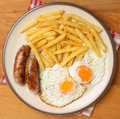 Sausages eggs and chips with fried Stock Photos