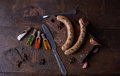 Sausages grilled food background, wood background. Royalty Free Stock Photo