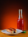 Sausages and ketchup still life with grilled Royalty Free Stock Photography