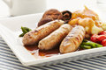 Sausages and mash in a plate on a blue strip placemat Stock Photo