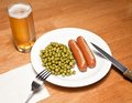 Sausages with mustard, peas and beer Royalty Free Stock Photo