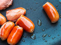 Sausages pork frying on pan Stock Photography