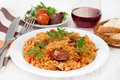 Sausages with rice on the plate and glass of wine Royalty Free Stock Photography