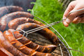 Sausages roasting: grilling Royalty Free Stock Image