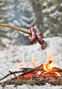 Sausages and winter campfire Royalty Free Stock Images