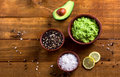 Sause guacamole and ingredients - avocado, salt, pepper and lemon Royalty Free Stock Photo