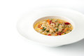 Saute with seafood on the white background horizontal ceramic plate Stock Photo
