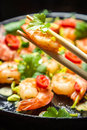 Sauteed shrimp on chopsticks Stock Photos