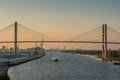 Savannah ga boat traffic at dusk on river below the eugene talmadge memorial bridge established in is the oldest town in Stock Photography