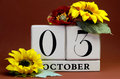 Save the date white block calendar for october rd with autumn fall colors fruit and flowers theme individual special occasions Royalty Free Stock Image