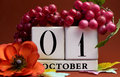 Save the date white block calendar for october st with autumn fall colors fruit and flowers theme individual special occasions Stock Photo