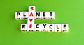 Save the planet text recycle in uppercase letters crossword style green background Stock Photo