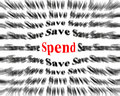 Save and spend closeup detail of black white words with red word Royalty Free Stock Photos