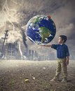 Save the world concept young boy holds word of Stock Photography