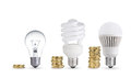 Savin money saved in different kinds of light bulbs Stock Photos