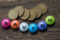 Saving Button with coins Royalty Free Stock Photo