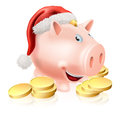 Saving for christmas concept cartoon piggy bank with santa hat on and gold coins money or club fund Stock Photo