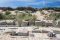 Saving the coastline. Coastal erosion management with concrete blocks. Sea defences in Royalty Free Stock Photo