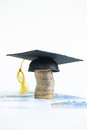 Saving for higher education with mortarboard on a stack of euro coins and banknotes Stock Photography