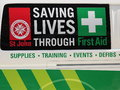 Saving lives through first aid signage on a ambulance van Royalty Free Stock Photo
