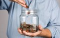 Saving Money In Jar Royalty Free Stock Photo