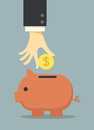 Saving money in piggy bank business hand Royalty Free Stock Photos