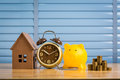 Saving money to buy a new home of its own money in the piggy bank. Lowest cost and tax. Royalty Free Stock Photo