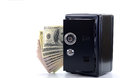 Saving your money steel safe with money over white background money insurance concept Stock Image