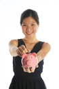 Savings and investment concept with an asian lady Stock Photo