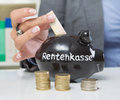 Savings for retirement in black piggy bank Stock Images