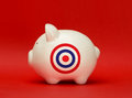 Savings on target white piggy bank with a bullseye printed it Stock Images