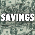 Savings word money pile accumulate wealth cash in d letters on a of hundred dollar bills Royalty Free Stock Image