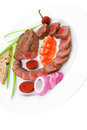 Savory meat served on white plate roasted bbq with tomatoes sprouts and bread isolated background Stock Photography