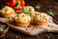 Savory muffins with Feta cheese, curd, pepper and herbs